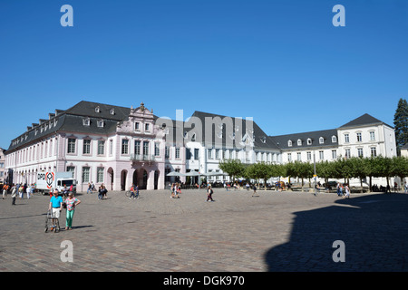 Tourists at the Domfreihof square in front of the cathedral of Trier, Germany - Stock Photo