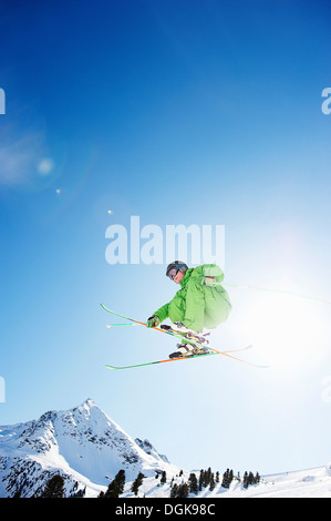 Skier jumping in midair - Stock Photo