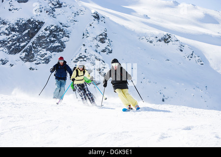 Group of friends skiing on mountain - Stock Photo