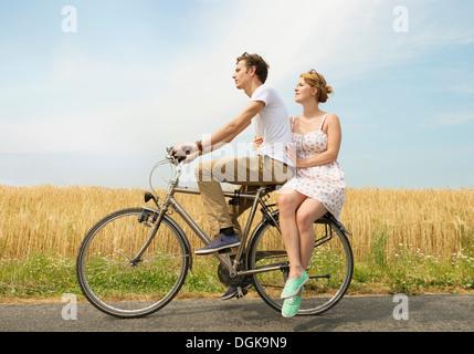 Couple riding bicycle - Stock Photo