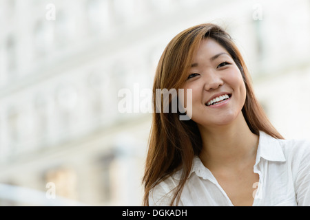 Business woman smiling looking into distance - Stock Photo