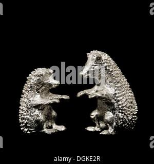 Pair of hedgehog ornaments - Stock Photo