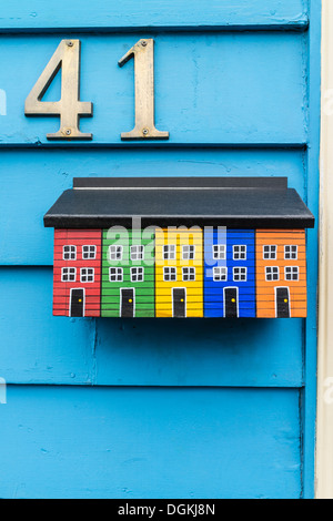 A custom made mailbox painted to replicate the facades of the iconic multi-colored houses of St. John's, Newfoundland. - Stock Photo