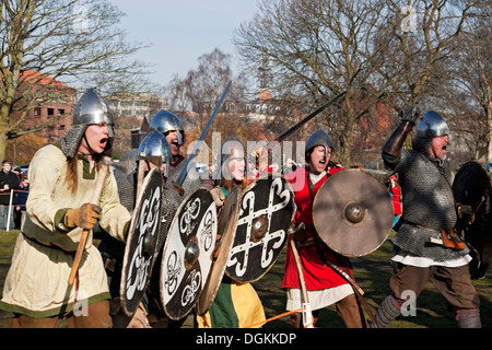 A skirmish reenactment between Vikings and Anglo Saxons at the Viking Festival. - Stock Photo