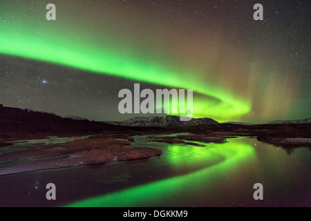 Aurora borealis over Lake Thingvallavatn in Thingvellir National Park in Iceland. - Stock Photo