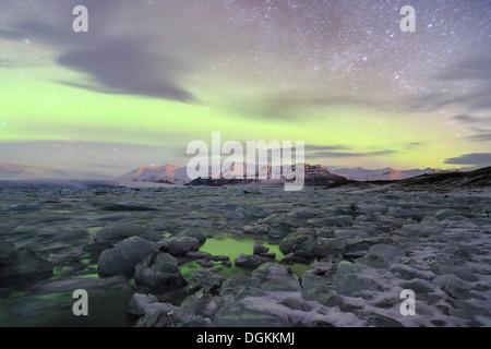 Aurora borealis over the Jokulsarlon Glacier Lagoon in Iceland. - Stock Photo