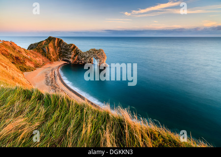 A view of Durdle Door from the clifftop path. - Stock Photo