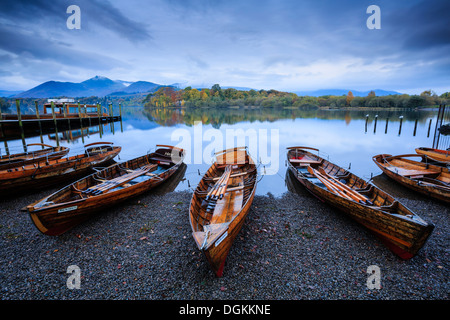 Rowing boats on the shore of Derwent Water near Keswick. - Stock Photo