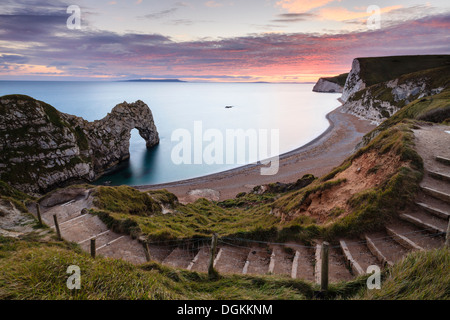 A view of Durdle Door from the cliff top path. - Stock Photo