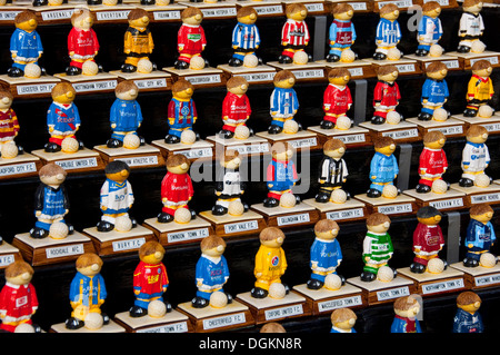 Painted models of football players in team colours. - Stock Photo