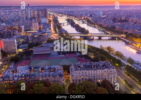 Aerial view of Paris from the Eiffel Tower at sunset. - Stock Photo