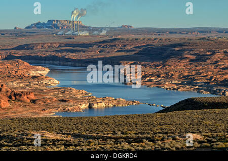 View over Lake Powell towards a coal power plant, Navajo Generating Station, Lake Powell, Page, Arizona, United - Stock Photo