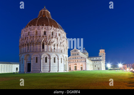 Baptistery with cathedral and Leaning Tower of Pisa at Piazza dei Miracoli. - Stock Photo