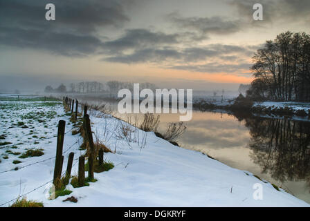Morning mood in winter on the banks of the Vecht River, Ommen, Holland, Netherlands, Europe - Stock Photo