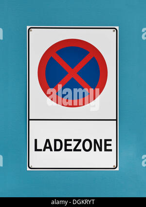 Sign in German, 'Ladezone', loading zone, no parking - Stock Photo