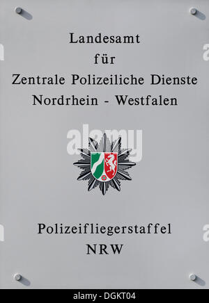 Sign 'Landesamt fuer Zentrale Polizeiliche Dienste Nordrhein-Westfalen, Polizeifliegerstaffel NRW', German for 'State - Stock Photo