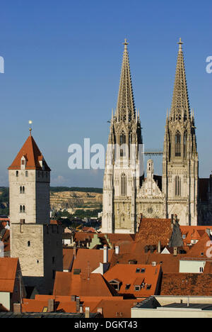 View over the rooftops of the old town to the Regensburg Cathedral of St. Peter, on the left the Goldener Turm tower, - Stock Photo