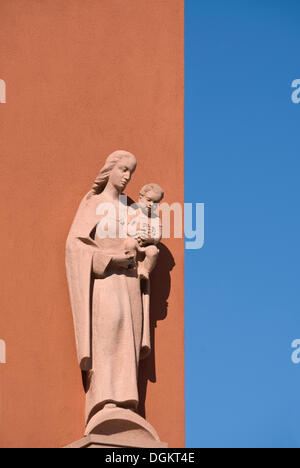 Sandstone statue of Mary with Jesus - Stock Photo