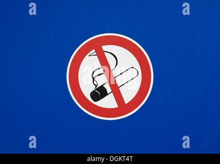 No smoking sign on a blue surface - Stock Photo