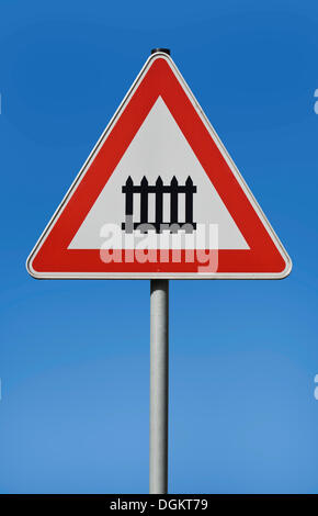 Traffic sign, railway crossing with gates - Stock Photo