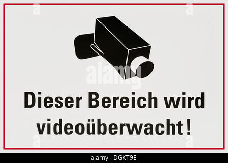 Sign with camera: Dieser Bereich wird videoueberwacht! or This area is under video surveillance! - Stock Photo