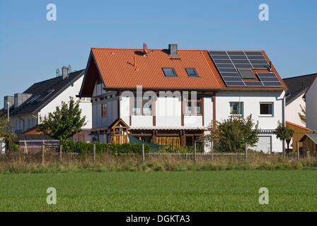 Multi-family house in a residential housing development with solar panels on the roof, PublicGround - Stock Photo