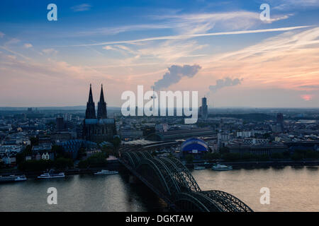 Cologne in the evening, dusk, view of Deutz Bridge, old town, Koelner Dom, Cologne Cathedral, Colonius and the Cologne - Stock Photo