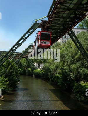 Wuppertal Schwebebahn or Wuppertal Floating Tram, suspension railway over the Wupper river, landmark of Wuppertal - Stock Photo