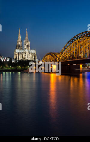 Evening view over the Rhine River towards Museum Ludwig, Cologne Cathedral and Hohenzollern Bridge, UNESCO World - Stock Photo