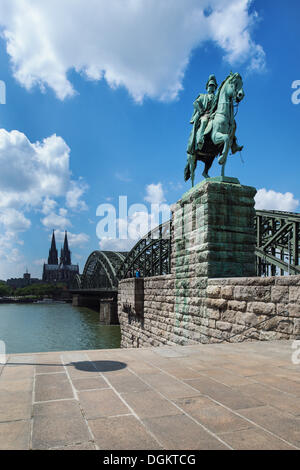 View from Cologne Deutz with the equestrian statue of Emperor Wilhelm I of Prussia towards Hohenzollern Bridge, - Stock Photo