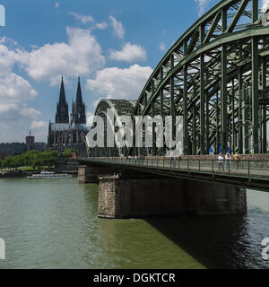 View across the Rhine River towards Cologne Cathedral and Hohenzollern Bridge, North Rhine-Westphalia - Stock Photo