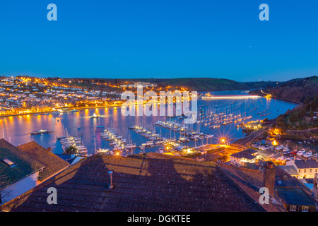 Boats moored on the river Dart with Dartmouth in the background. - Stock Photo