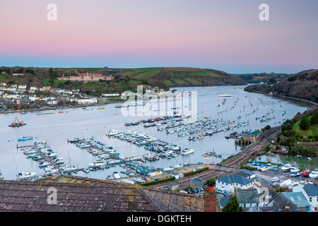 Boats moored on the river Dart with Royal Naval College in the background. - Stock Photo