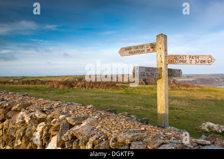 Signpost on the South West Coast path near Sharp Tor. - Stock Photo