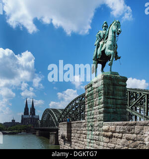 View across the Rhine River from the equestrian statue of Emperor Wilhelm I of Prussia towards Hohenzollern Bridge, - Stock Photo