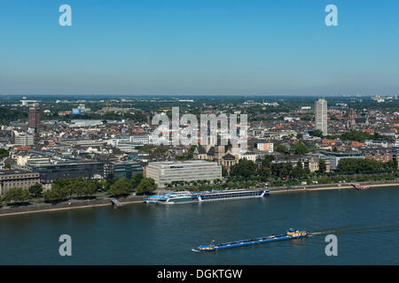 View of Neustadt Nord district and the Rhine river as seen from Deutz, cargo ships floating on the Rhine river, - Stock Photo