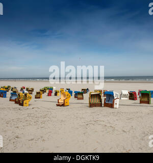 Roofed wicker beach chairs on the beach of Juist island, North Sea, Lower Saxony Wadden Sea, East Frisia, Lower - Stock Photo