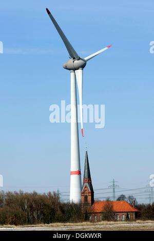 Wind turbine beside the old Church of St. Gertrud, Altenwerder, Hamburg, Hamburg, Germany - Stock Photo