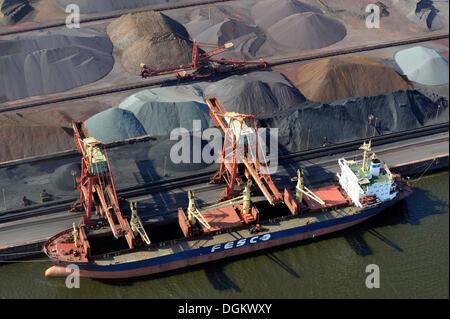 Aerial view, a ship of the Russian Far Eastern Shipping Company is unloading Russian ore, Hamburger Hansaport, Hamburg, - Stock Photo