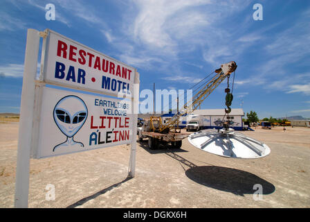 UFO hanging on the tow hook in the car park of the 'Little A'Le'Inn' pub, Rachel, Rachel, Nevada, United States - Stock Photo