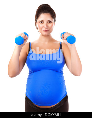Sportive pregnant girl lifting dumbbells isolated on white background, workout indoors, sport for expectant female - Stock Photo