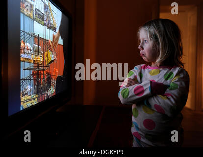 Little girl watching television