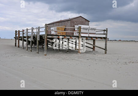 Building built on stilts, beach on the North Sea, St. Peter-Ording, Schleswig-Holstein - Stock Photo