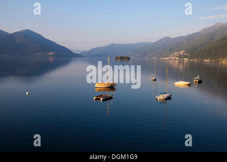 Morning mood and boats in front of the Brissago Islands, view from Casa Moscia, Ascona, lake Lago Maggiore, Ticino, - Stock Photo
