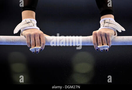 Detail, gymnast with hand protection for the high bar and uneven bars - Stock Photo
