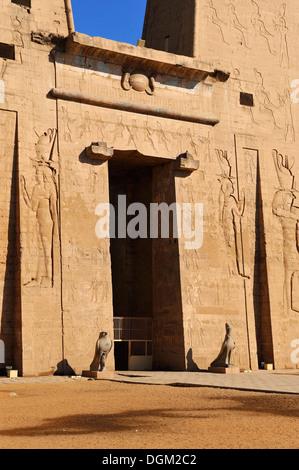 Entrance Pylon to Temple of Horus at Edfu, Upper Egypt - Stock Photo