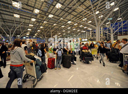 Passengers waiting in line at the check-in, Stuttgart Airport, Baden-Wuerttemberg - Stock Photo