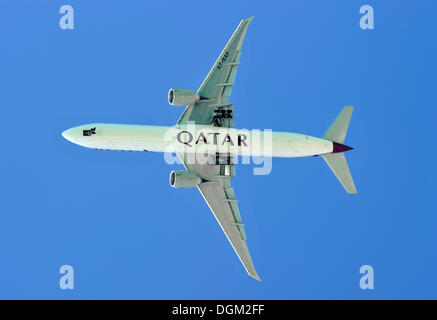Airplane of Qatar Airways in the sky - Stock Photo