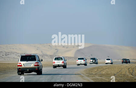 Convoy of SUVs, 4x4, sand dune, desert, Emirate of Qatar, Persian Gulf, Middle East, Asia - Stock Photo