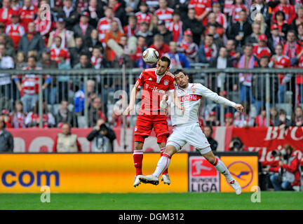 Duel, Diego Contento, FC Bayern Munich, left, vs. Timo Gebhart, VfB Stuttgart, right, Allianz Arena, Munich, Bavaria - Stock Photo